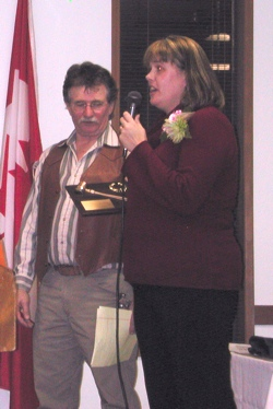 Kari Alexander, the 2009 Tonasket Chamber of Commerce President, presented David Kester, outgoing Chamber President, with the 2008 Chamber President's Award. Kester was also awarded Citizen of the Year by the organization at the chamber banquet held Thu