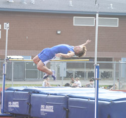 Tonasket sophomore John Stedtfeld bends over the bar in the high jump, clearing it, during the Tonasket Invitational track meet on Friday, April 16. Stedtfeld came in fifth place with a jump of 18-00.00. Photo by Emily Hanson