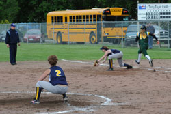 Lady Hornet Chandra Hutsell stretches to make the forced out at first base a close call going against the Liberty Bell runner. Photo by Gary DeVon