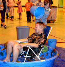 Oroville Elementary Principal Gary Pringle gets a bucket of water dumped over his head as a reward to the students who read 7,621 books in the Principal's Challenge. Submitted photo