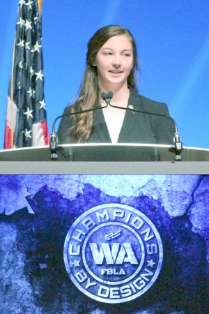 Newly Elected President Tori Kindred Speaks to the audience of two thousand members and advisers at the Washington State FBLA Business Leadership Conference held at the Performing Arts Center, INB in Spokane.