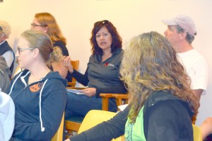 Roni Holder-Diefenbach of the Okanogan County Economic Alliance answered several questions for community members at Tonasket City Hall Monday, Aug. 31. Next to Diefenbach is Melissa Carpenter, Eastern Washington Representative from the Governor's office. Katie Teachout/staff photo.