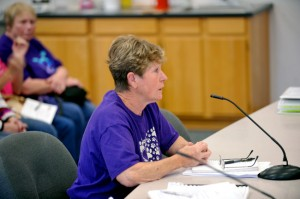 Carol Richards, who is seeking a Conditional Use Permit to operate a dog kennel from her property, testifies before the Hearings Examiner Thursday. Gary De Von/staff photo