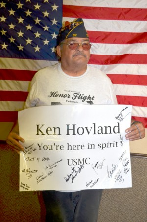 William Gomez and his sign honoring his friend Ken  Hovland.