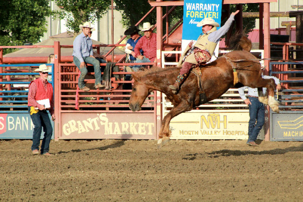 Laura Knowlton/staff photos Keifer Larson on Broncomadic and Chrisoph Muigg on Tombstone tied for first place in the bareback riding, each taking home a prize of $658.35.