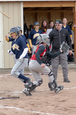 Photo by Gary A. DeVon                Oroville's Reinna Quick is brought home on an Emily Graham triple last week against the Waterville Shockers. The Hornets easily won each o