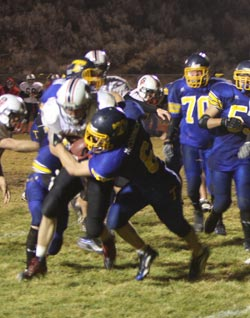 Tonasket defensive back Keegan McCormick tackling an Omak running back on Thursday, Oct. 29. The Pioneers were too fast for the Tigers and Tonasket lost at home 48-7. Photo by Terry Mills