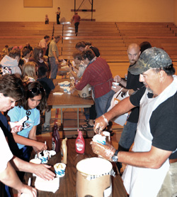 Oroville School Board members serve ice cream to elementary school students and their parents following an open house last Monday evening, Aug. 30, the first day of school for the Oroville School District. Photo by Gary DeVon