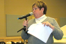 Joanne Morris of Oroville addresses the crowd at the Okanogan County Public Utilities District's information meeting on Tuesday, April 19. She said the straw that broke the camel's back for her in regards to the PUD's rates was when she realized she