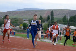 Oroville Hornet Emily Mills competes at the 2B District Championships held at Eastmont High School in East Wenatchee on Saturday, May 21. Mills and her fellow Hornets on the girls' team took the District Championship. She was first in the 100, 200 and 4