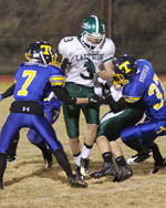 Tonasket's Jeff (7) and John (37) Stedtfeld gang up on a pair of Lakeside players during the Tigers' final game of the season on Friday, Nov. 4.