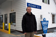 Midway Mayor Randy Kappes stands beside the border port that he says links Midway to future prosperity.