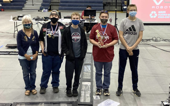 Submitted photo Oroville Robotic's Team Coach Laara Peters-Kessler, winner of the Team Mentor Genius Award and Outstanding Roboteer winner Odin Finsen with teammates and fellow champions Michael Oaks, Tyler Charnholm and Trevor Miller.